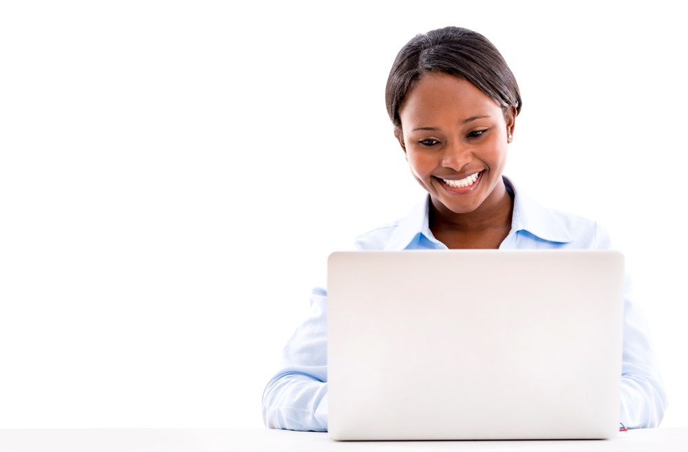 Business woman working online on a laptop computer - isolated